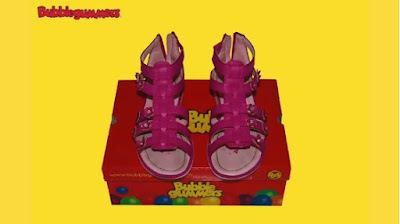Pair of pink girl Bubblegummers shoes on red box