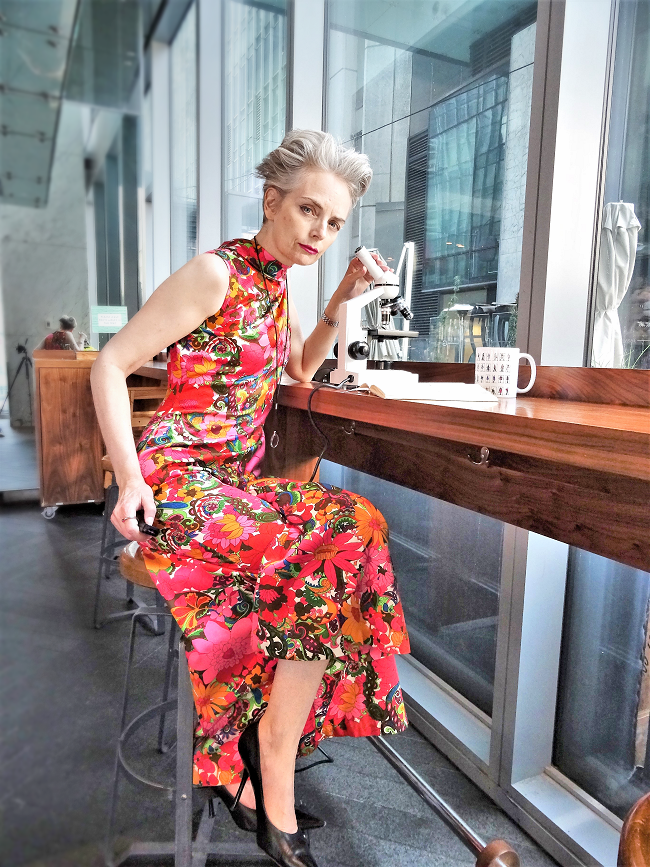Mel Kobayashi of Bag and a Beret, vintage floral jumpsuit and microscope