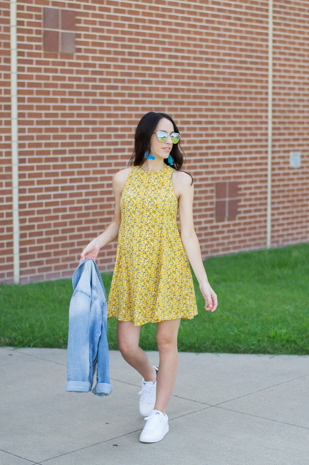 Wearing sneakers and a summer dress