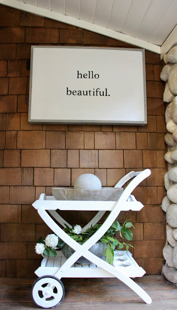 Cottage style on a charming porch with white bar cart and Hello Beautiful sign. My Sweet Savannah.