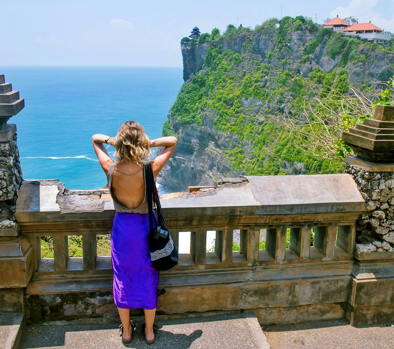 Fashion and Travel Blogger, Alison Hutchinson, at the beautiful view of Uluwatu Temple in Bali, Indonesia