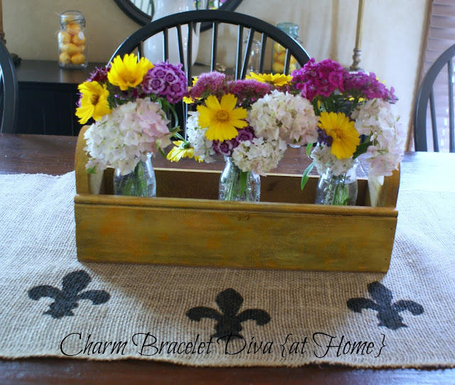 garden flowers vintage milk bottles wooden tool box stencilled burlap table runner centerpiece