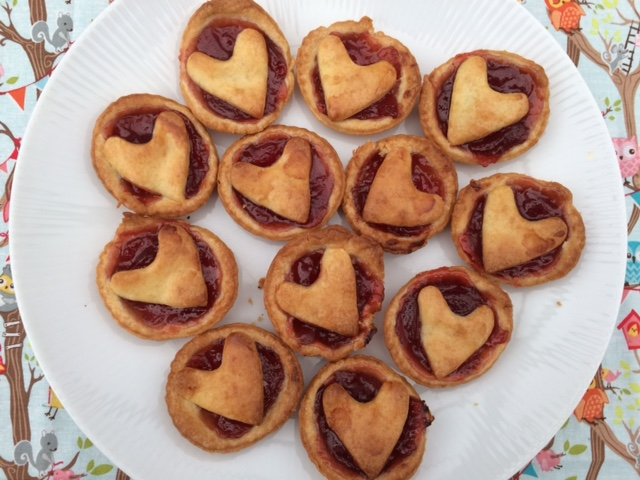 Plate of jam tarts with heart tops