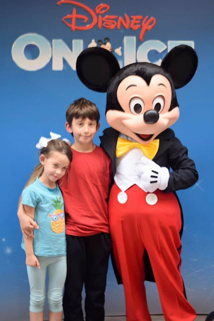 Boy and girl with Mickey Mouse - Disney on Ice