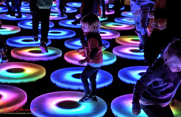 Child Dancing-  Pool by Jen Lewin, Vivid Sydney 2014. An interactive light pool for all ages, the light disks change colours with the movement of the group.