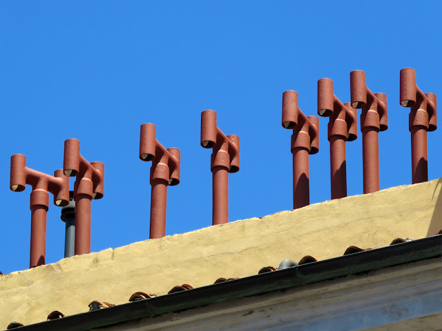 A platoon of chimneys seen from Piazza Giovine Italia, Livorno