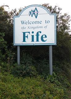 Sign readnig Welcome to the Kingdom of Fife, north side of the Forth Road Bridge, North Queensferry, Scotland