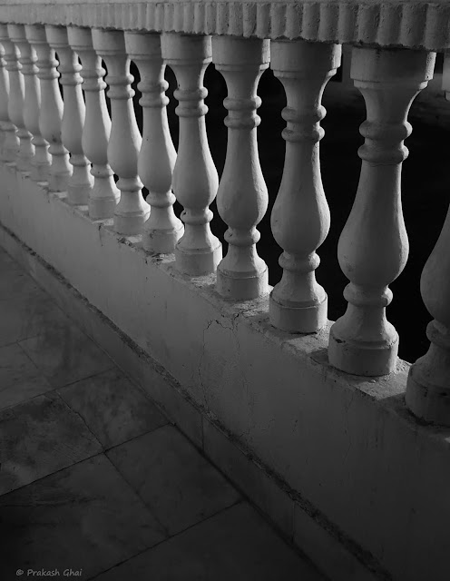A Black and White Minimalist Photograph of a Cement Side rail with a repeating pattern shot via Samsung S6 Smartphone Camera