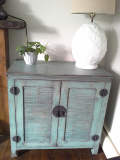 Distressed green cabinet asian influence