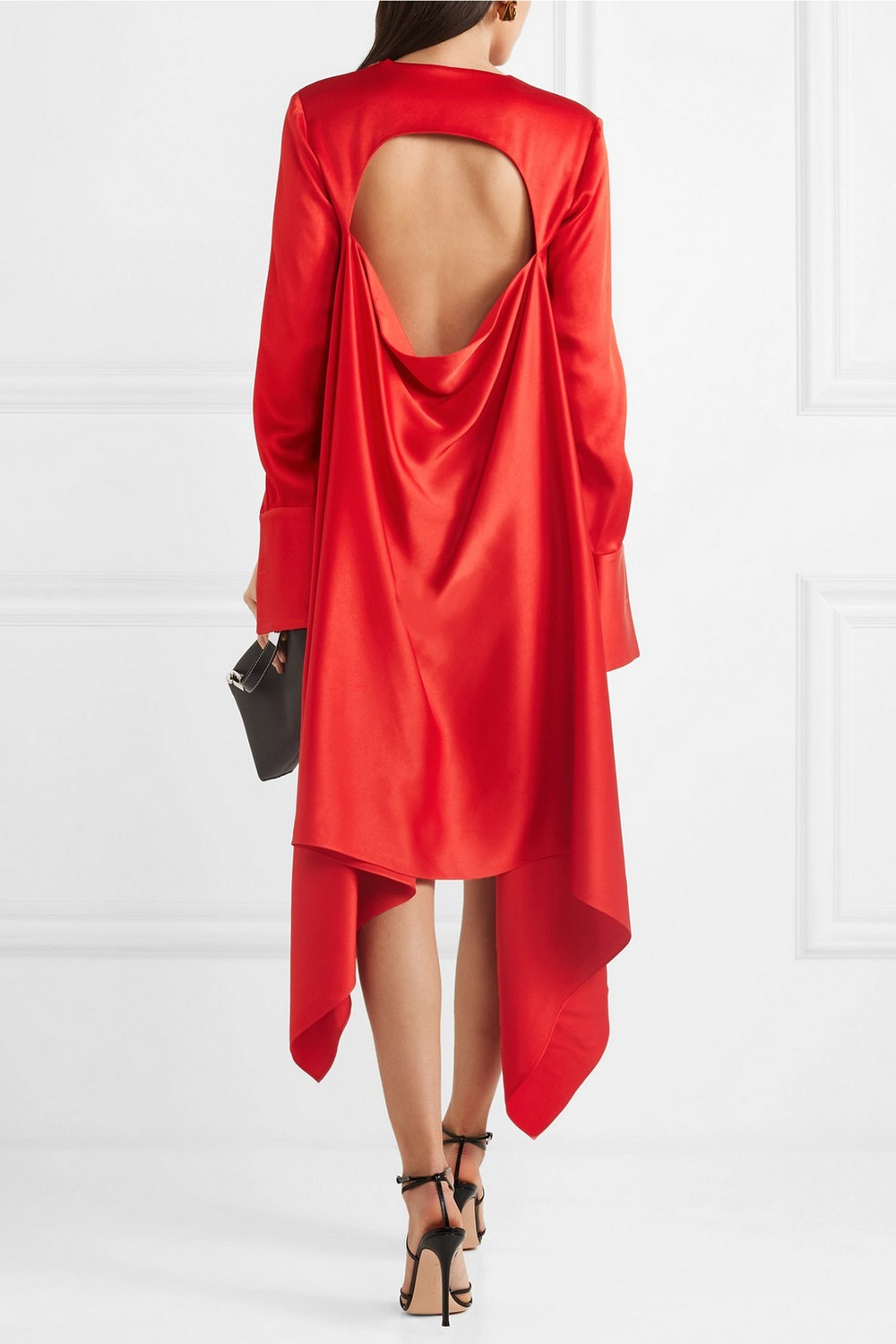 This satin midi dress with exposed back by Monse (around S$3,009 via Net-a-Porter) totally one-ups what Rachel wore, but references it perfectly with the cut-out. We love the elegant long sleeves, and how it swishes around the legs.
