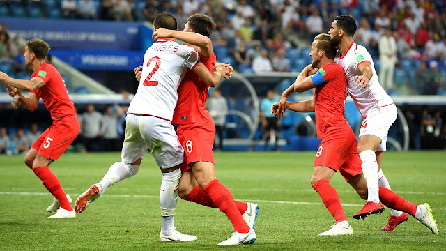 Tunisia players close marking on Harry Kane agains England