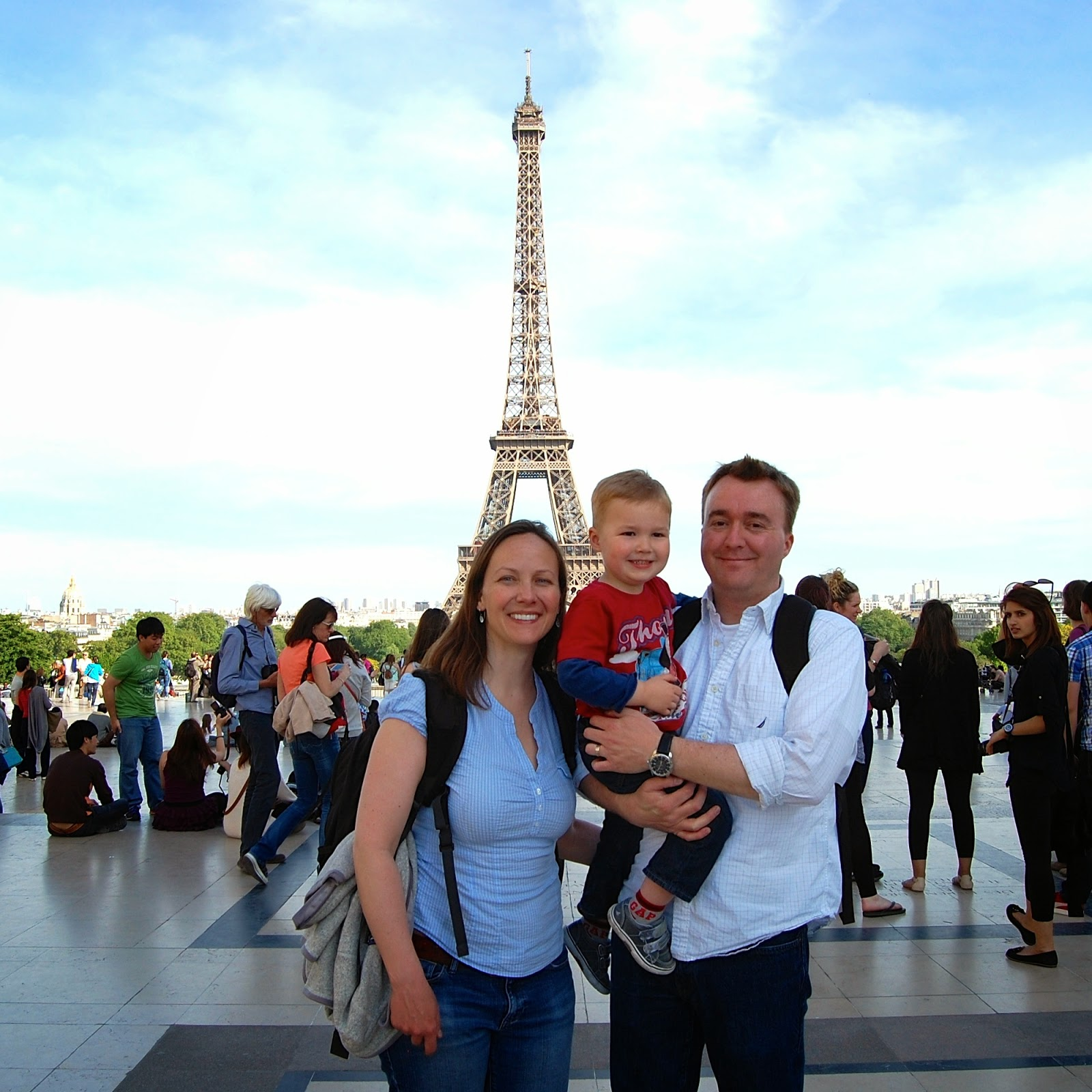 Family pic in front of the Eiffel Tower