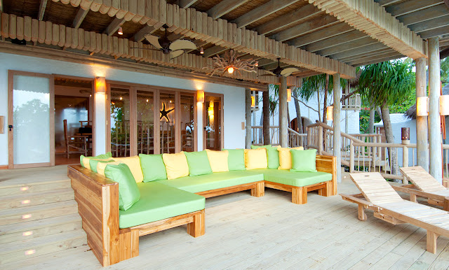 Photo of large wooden couch on the covered terrace