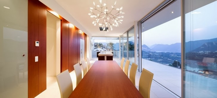 Dining table in Beautiful House Lombardo by Philipp Architekten
