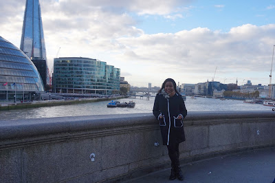 Tausha Cowan in front of the Tower Bridge in London