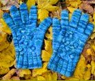 http://www.letsknit.co.uk/free-knitting-patterns/grayson-cabled-gloves