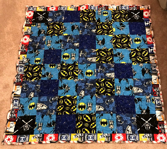 boy quilt with superheros and space