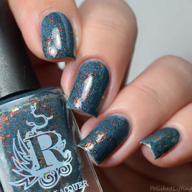 teal nail polish with flakies