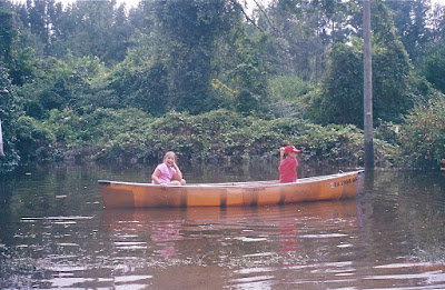 Zack Wiant canoes his sister around the yard after Gaston flooded Richmond