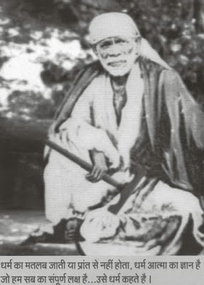 baba is holding his Satka with a stole on his back and regular dress
