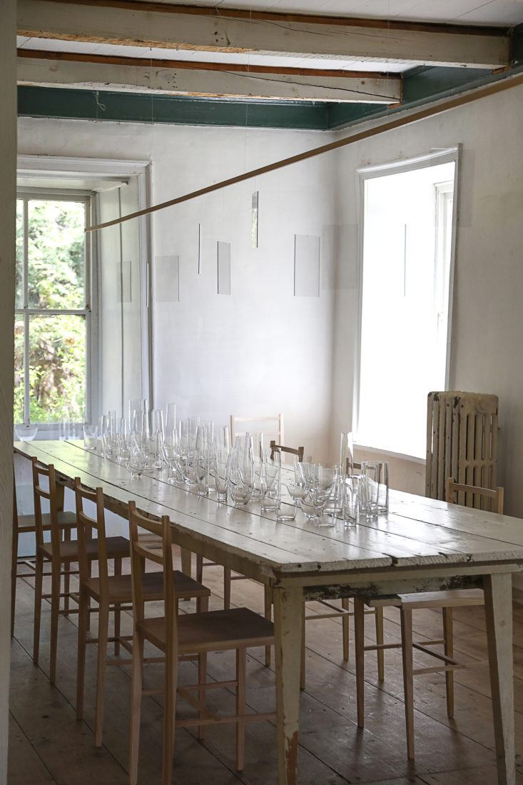 Ethereal and serene farmhouse dining table and chairs with modern lighting - found on Hello Lovely Studio