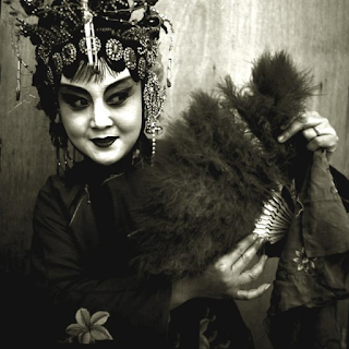 Peking Opera Actress Holding Fan, Beijing, 1996 © Liu Zheng