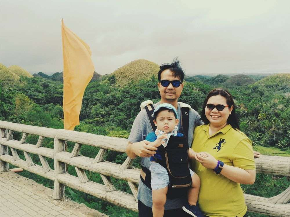 Mommy, Daddy, and Miguel with the Chocolate Hills at the background