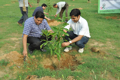Larsen &Toubro Delhi CSR team planting fruit trees at an orphanage in Delhi NCR