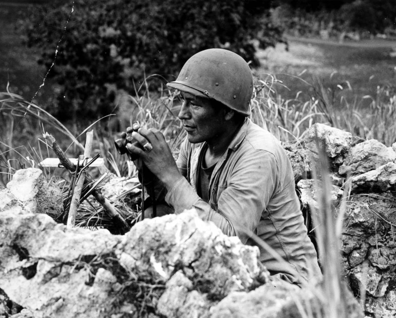 Carl Nelson Gorman, one of the original 29 Navajo code talkers, tracks enemy movements on Saipan. 1944.