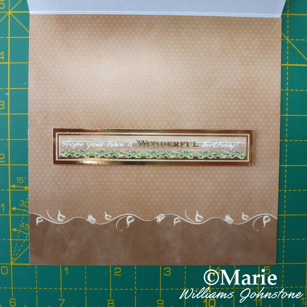 Inside of decorated square easel card with greeting stuck on with 3d foam pads
