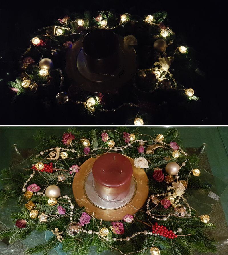 Weihnachtsdeko mit Rosen, Tannenzweigen, Kugeln und Lichterkette