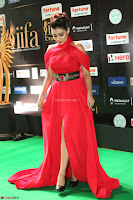 Apoorva in a Stunning Tight Leg Split Sleeveless Red Gown at IIFA Utsavam Awards 66.JPG