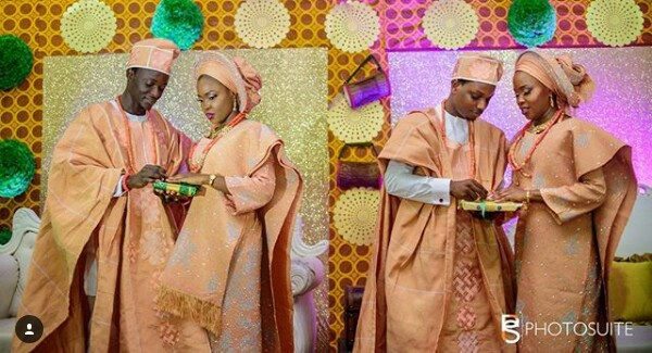 Photo of Nigerian parents crying at the double wedding of their beautiful twin daughters