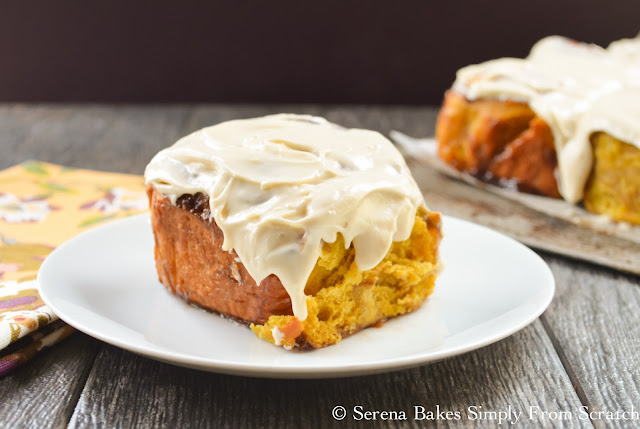 Pumpkin Cinnamon Rolls With Maple Cream Cheese Frosting are the perfect way to start the morning. serenabakessimplyfromscratch.com