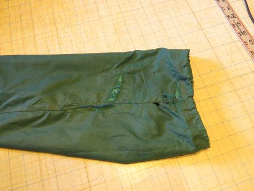 torn nylon rain suit