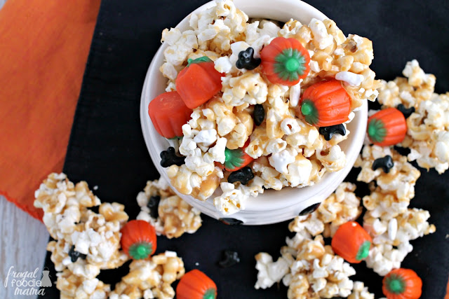 Candy pumpkins and ghost shaped sprinkles are tossed with peanut butter coated popcorn in this irresistible Haunted Pumpkin Patch Popcorn Crunch.