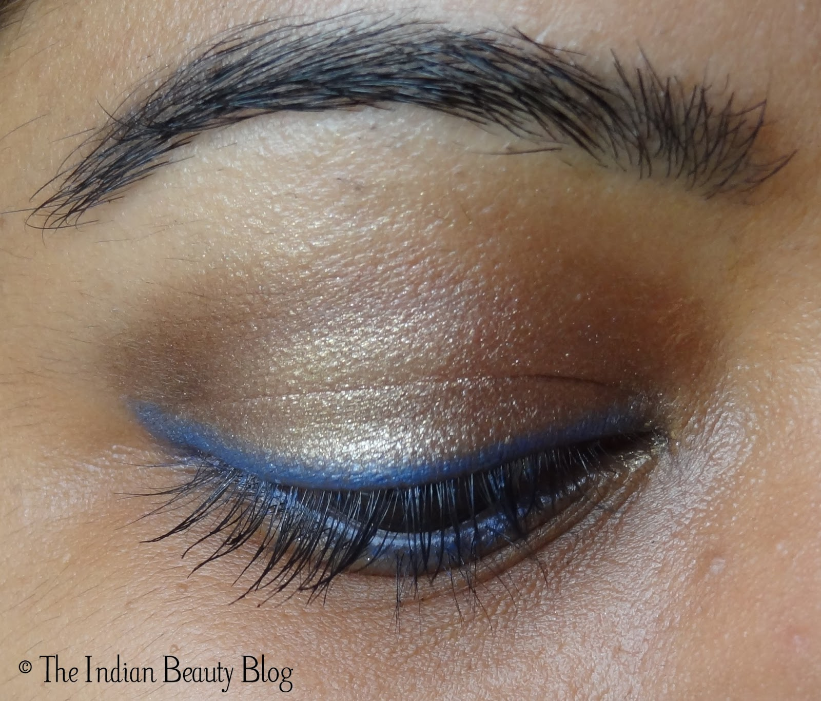 Copper-brown eye make-up with blue eyeliner and kohl: make ... - photo#4