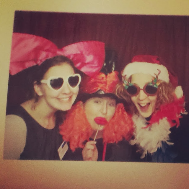 Three girls being silly in a photo booth