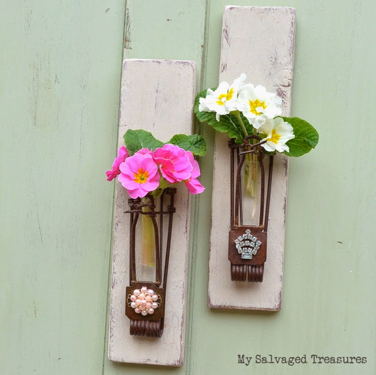 wall sconces made from pallets, gopher traps, and vintage jewels
