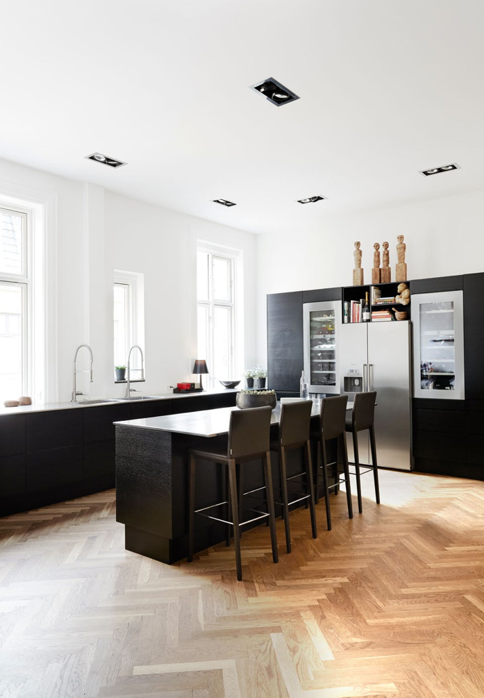 The black pops in this white kitchen