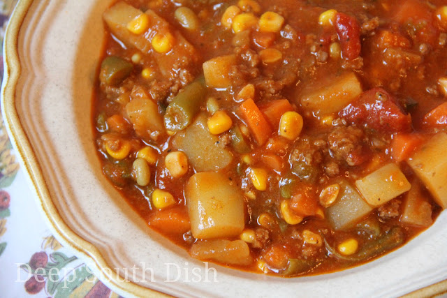 Hobo Stew, made with ground beef, a mixture of vegetables, canned tomatoes and V-8.