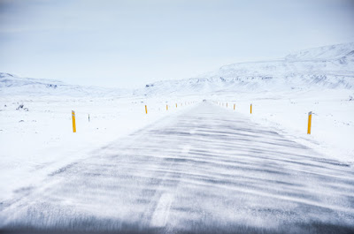 Snowy icy road while driving in Iceland in winter