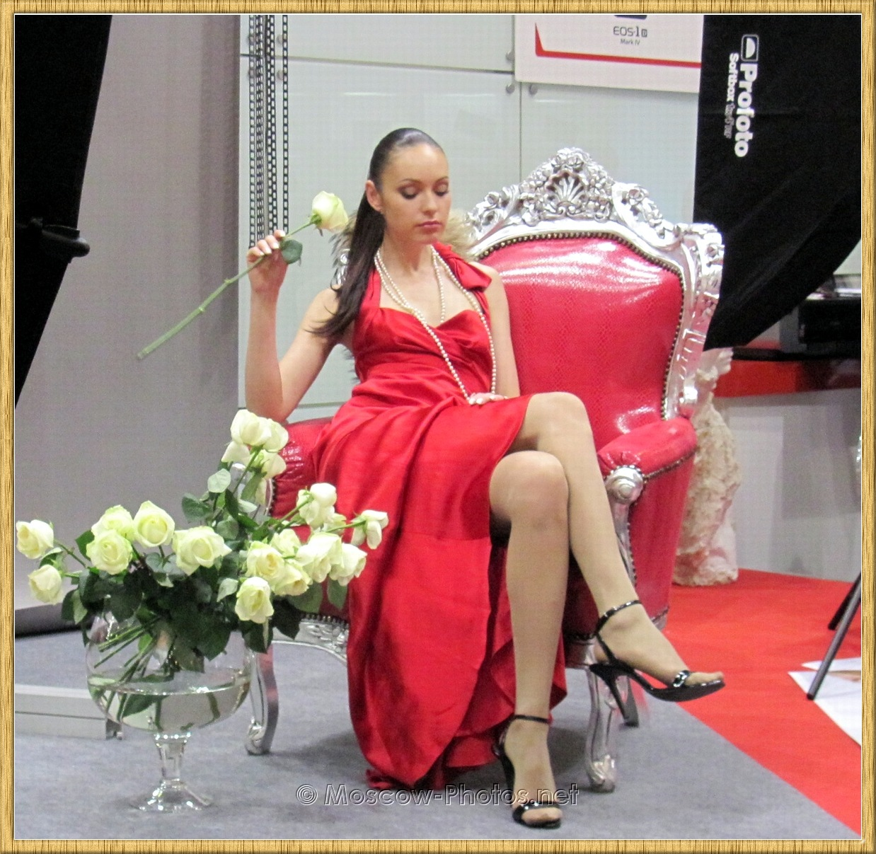 Long Haired Moscow Model In Red Dress Sitting On A Chair