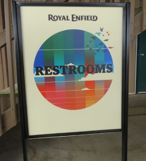 "Royal Enfield theme ""Restrooms"" sign."