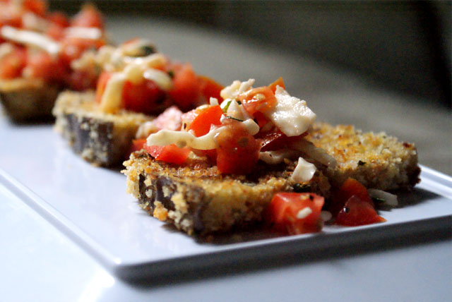 Skinny Bruschetta that uses crispy baked eggplant slices instead of toasted bread.