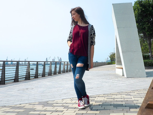 Kicking Back - outfit of black ad white print cardigan, loose red top, ripped blue skinny jeans, and red Converse sneakers
