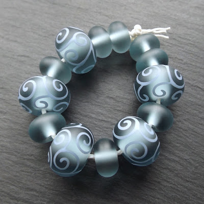 Lampwork glass tumble-etched beads with an oilve oil and beeswax finish