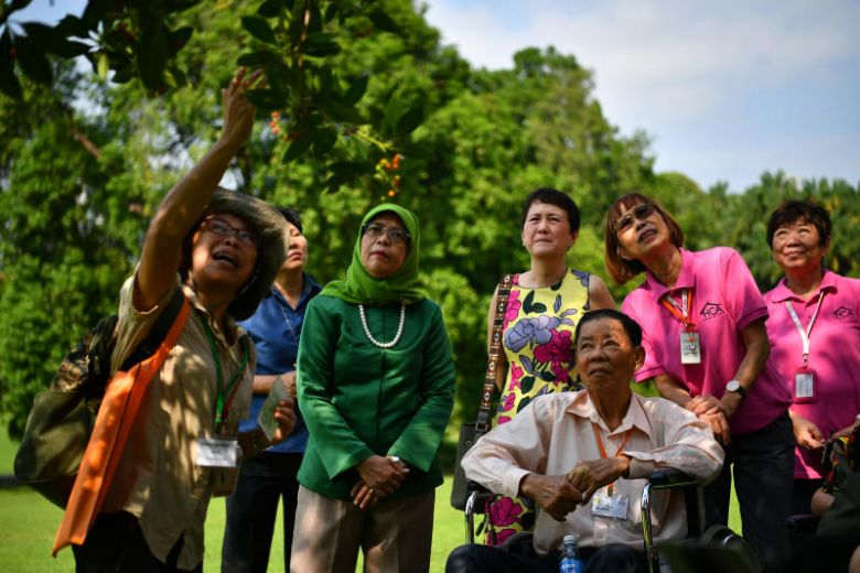 President Halimah welcomes HCA Hospice Care beneficiaries to tour Istana gardens