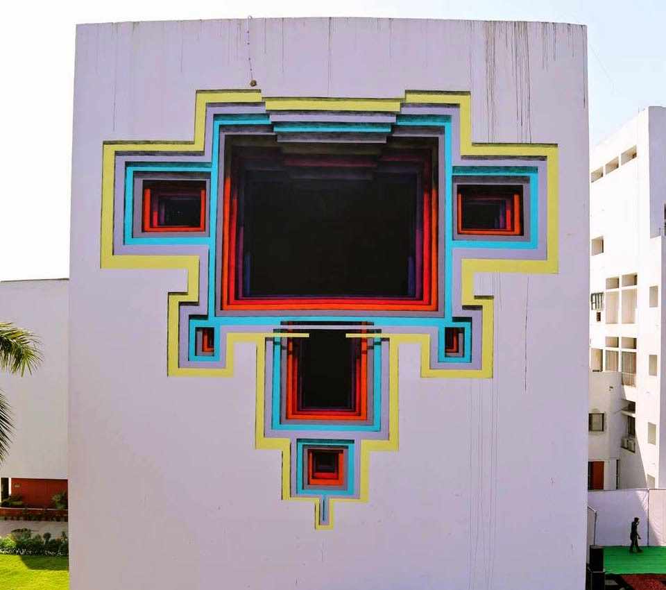 While we last heard from him in Panama a few days ago, 1010 is now in India where he was invited to paint for the St+Art India Street Art Festival.