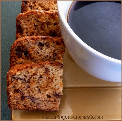 Toffee Butterfinger Banana Bread: Not your average banana bread, butterfinger buts and toffee chips baked into this quick bread adds a whole new layer of flavor. | Recipe developed by www.BakingInATornado.com | #recipe #bananas #bread